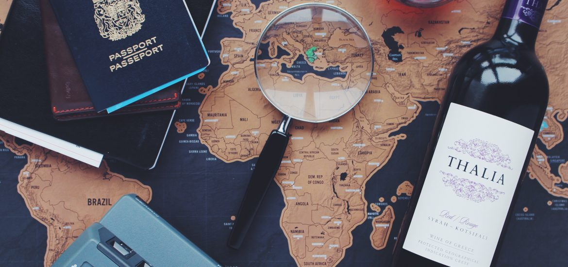 Might be Moving? Map, magnifier, wine and passport